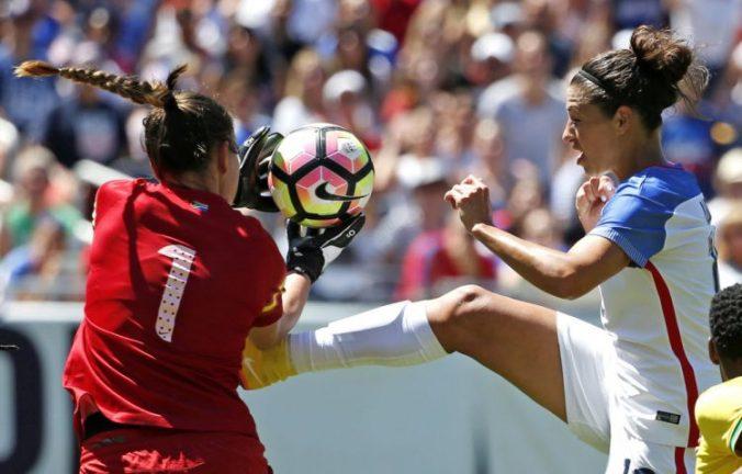 South Africa goalkeeper Roxanne Barker stops a shot by Carli Lloyd, July 9, 2016. (Nam Y. Huh/AP)